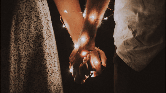 boy and girl hold hands
