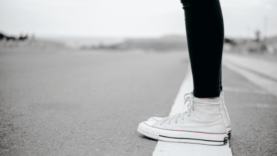 girl standing on a white line