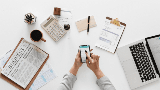 tools for a financial future: phone, laptop, clipboards