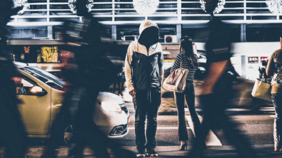 faceless boy in the middle of street