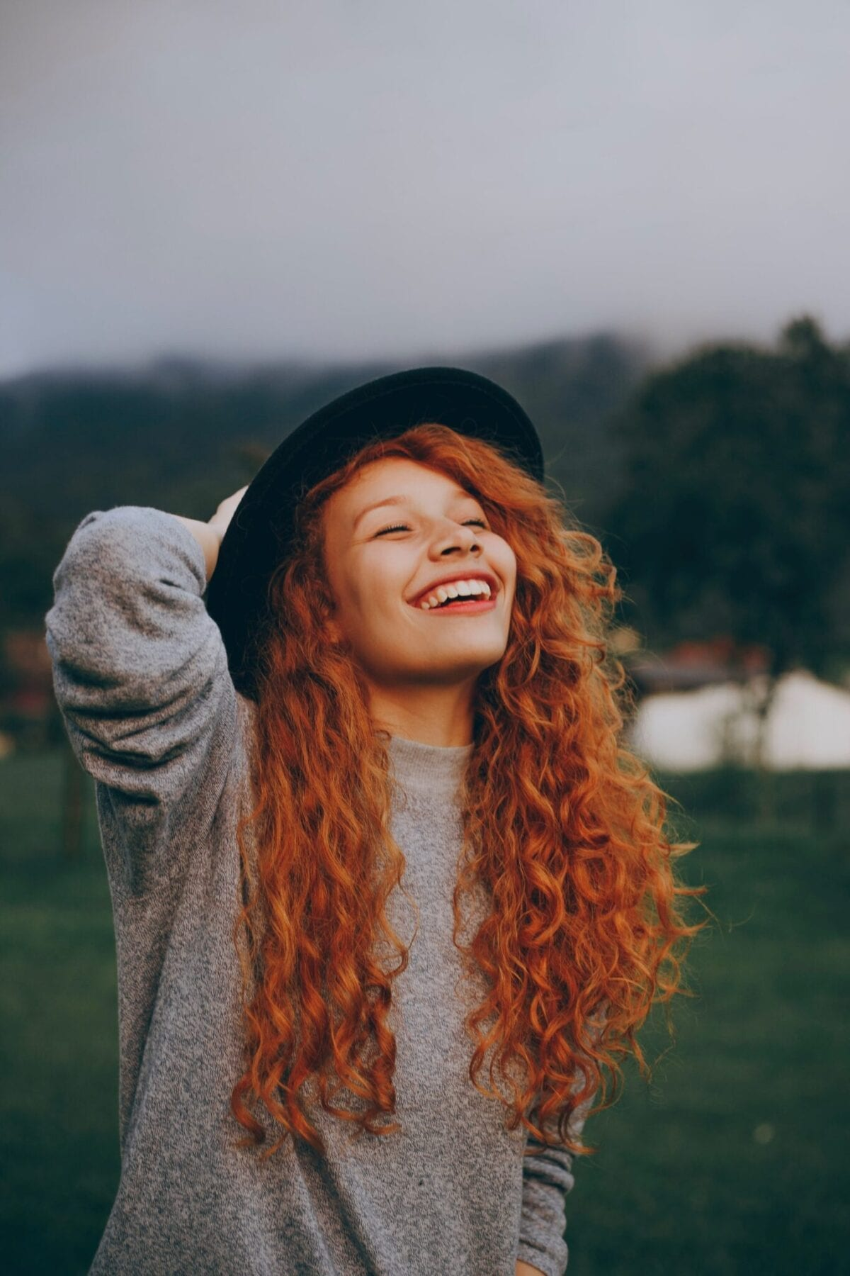 girl with red hair laughing