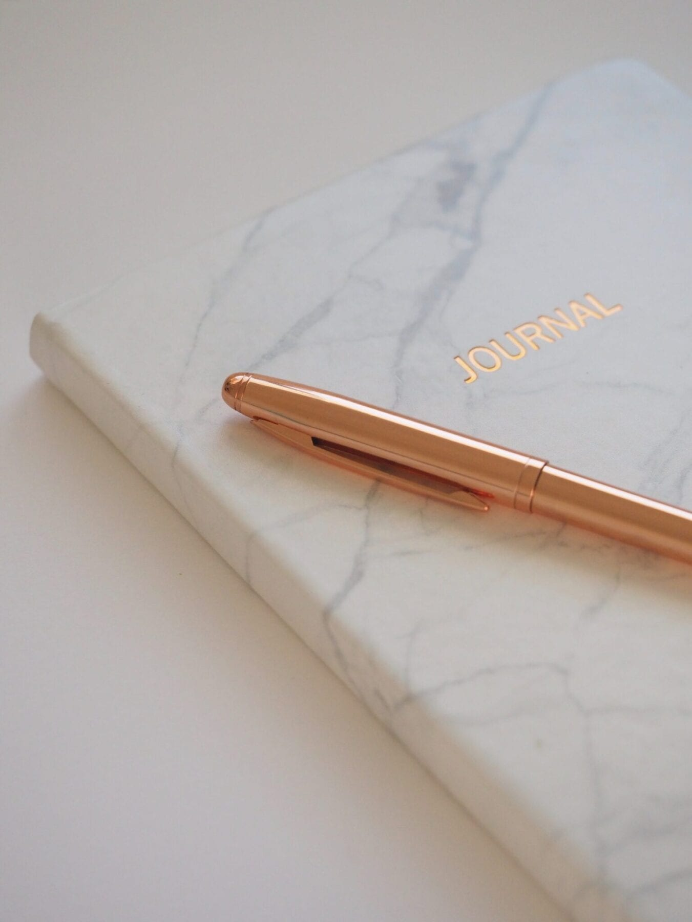 Gold Pen on Journal Book To Develop Curiosity