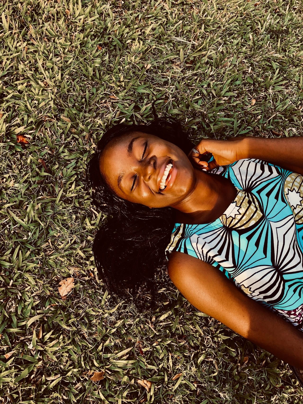 Woman Smiling Lying on Grass