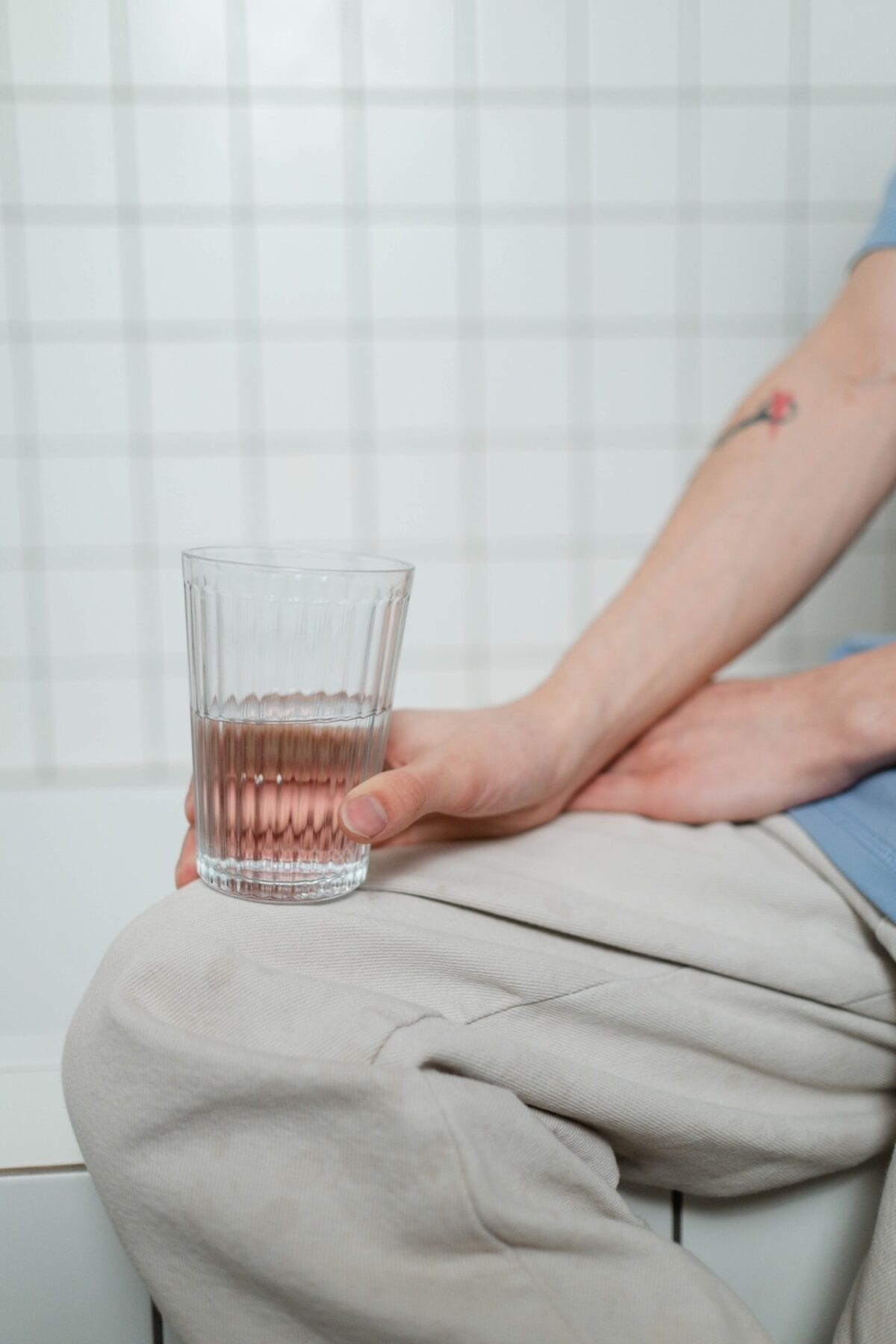 woman holding a water glass
